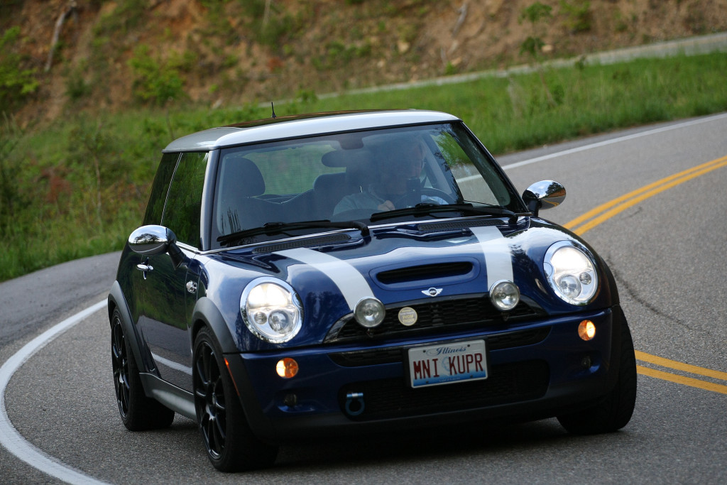 "Brian and Angie Davis - 2004 Cooper S / White/Indi Blue / Sunroof / Black Grill / Sport Package / Cold Weather / OZ/Sparco Assetto Gara 17"" Black wheels / Michelin Pilot Sport A/S Plus / JCW CAI / JCW Strut Brace / JCW Brakes / Borla CAT back exhaust / WMW 15% Pulley Package / WMW ECU Performane Tune ."