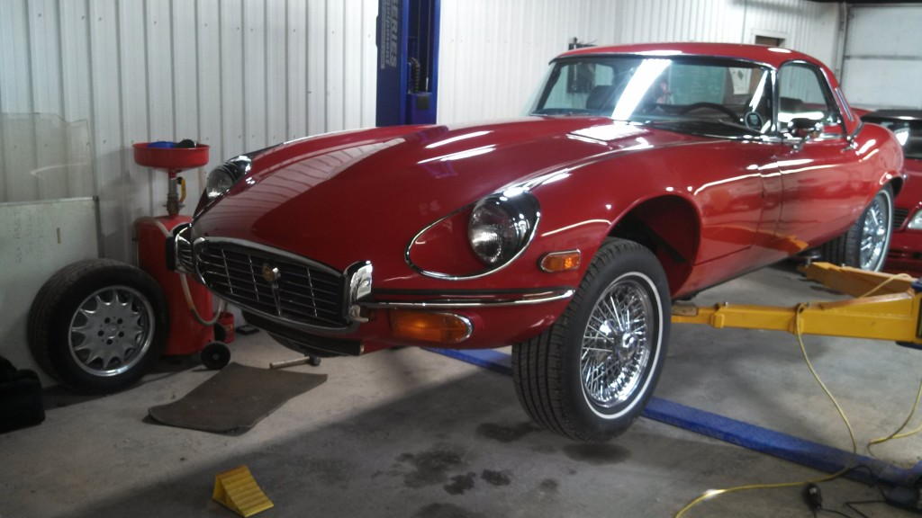 Larry Philyaw (Owner) - The XKE is a 1974 V12 automatic, (I modified the original big rubber bumpers) which is undergoing exterior restoration in the paint shop.