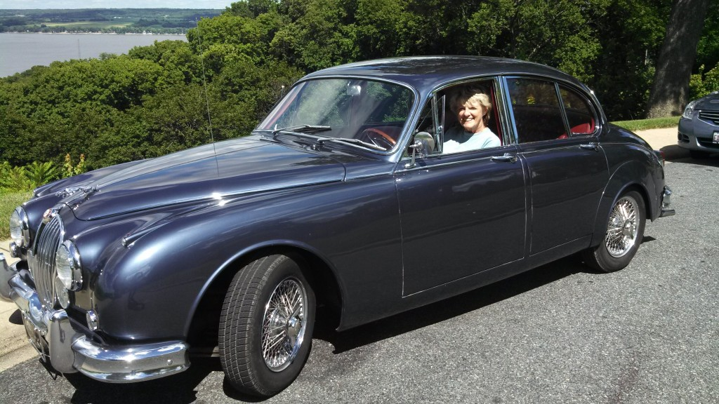 The MK2 is a 1961, original with an older restoration and a great driver. It is the 3.8, 4 speed with overdrive. That is Alice (Maggie) Oest sitting in it, pretending she can drive a stick.